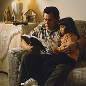 Man and girl reading scriptures