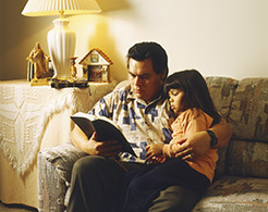 father and daughter reading the scriptures