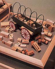 Pack a wagon with blocks labeled to represent items the pioneers
