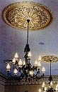 Three chandeliers were made to duplicate those in early photographs