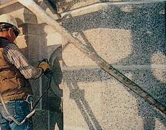A worker smooths granite stone