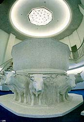 The oxen that support temple fonts symbolize the tribes of Israel and the strength upon which God's work rests