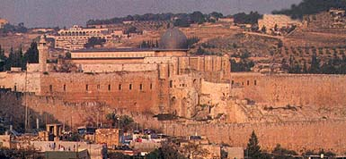 The arches of the Jerusalem Center are visible on the horizon near the center of this photograph of Jerusalem.