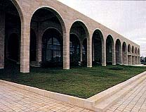 The multiple arches of the center, such as these across the front of the auditorium, repeat an architectural design that is common in Jerusalem.