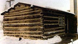The log cabin home during the winter of 1847–48