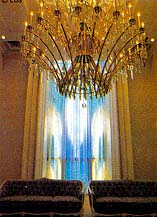 Stained-glass window, hazy through the drapes, and chandelier in the Tokyo Temple