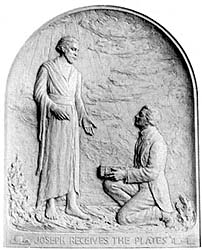 A bas-relief of Joseph receiving the plates