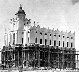 This photo of the St. George Temple taken some time between 1873 and 1877 shows the lower half of the red sandstone walls being readied for a coating of whitewash. This was prior to the construction of the taller tower now familiar to temple vis
