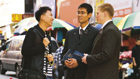 missionaries talking to a man on the street