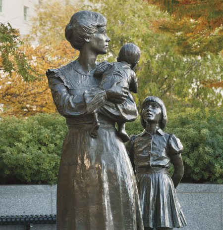 statue of mother and children
