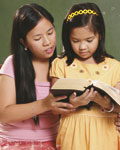 girls reading scriptures