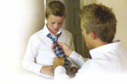 young man tying tie