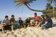 youth on beach with guitars