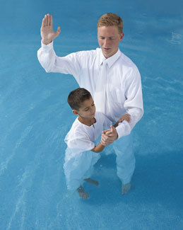 boy being baptized
