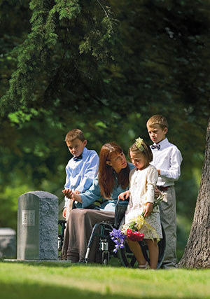 mother with children by gravestone