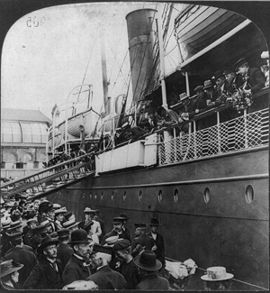 passengers at rail of steamship