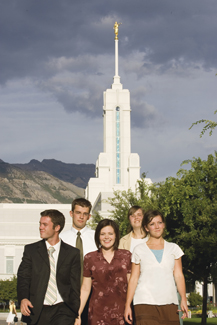 young adults in front of temple