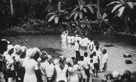 Nigerian converts being baptized