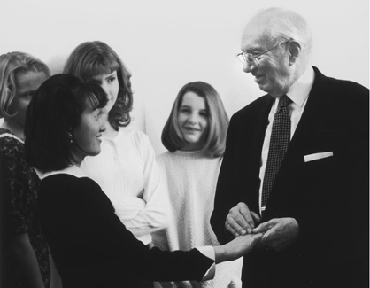 President Hinckley greeting young women