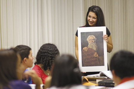 teacher showing picture to class