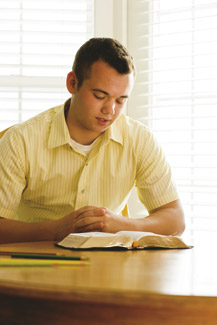 young man reading scriptures