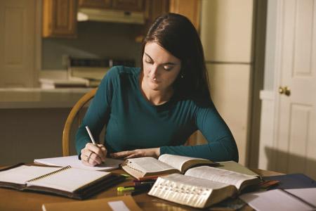 girl taking notes