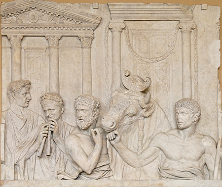 relief sculpture of men and animal