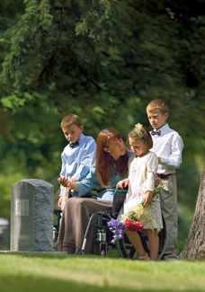family at gravestone