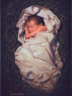 blanketed infant laid in hay