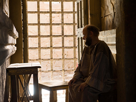 Paul in prison cell