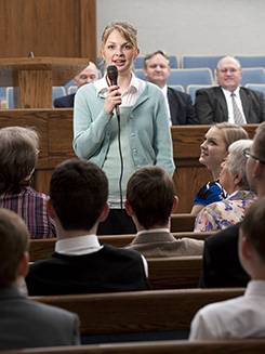 young woman speaking into microphone