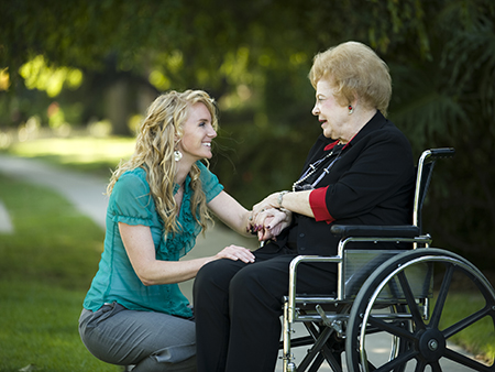 woman and older woman in wheelchair