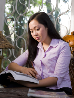 young woman reading scriptures