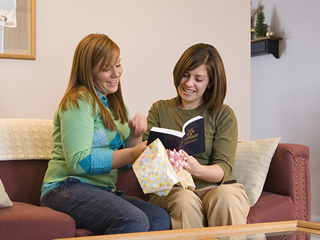 women sharing Book of Mormon