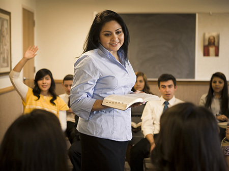 woman teaching class of youth
