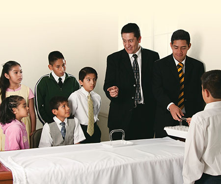 Primary class gathered at the sacrament table