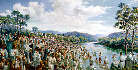 crowd at baptism in river