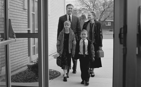 family walking into church