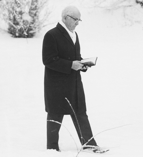 Spencer W. Kimball walking in snow with scriptures open