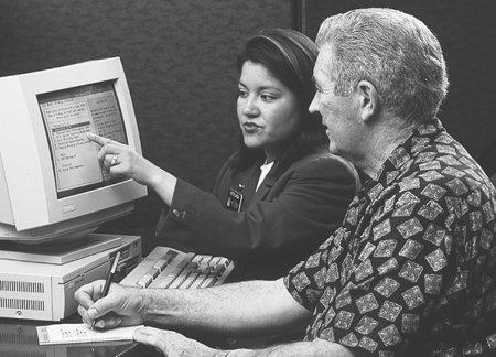 man and woman using FamilySearch