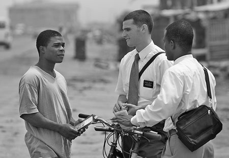 Missionaries talking to man