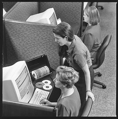 Women at family history computer