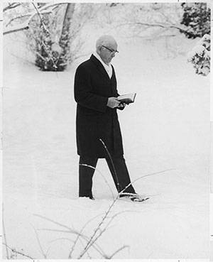 President Spencer W. Kimball studying scriptures