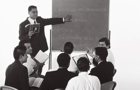 Male teacher in classroom