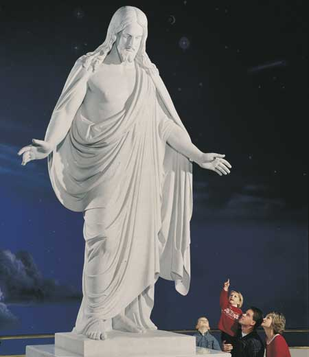 Family learning of Jesus at the Statue of the Christus