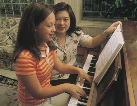 Mother and daughter at the piano