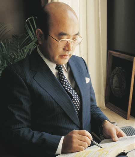 Elder Yoshihiko Kikuchi, emeritus general authority of the Church of Jesus Christ of Latter-Day Saints, studying his scriptures