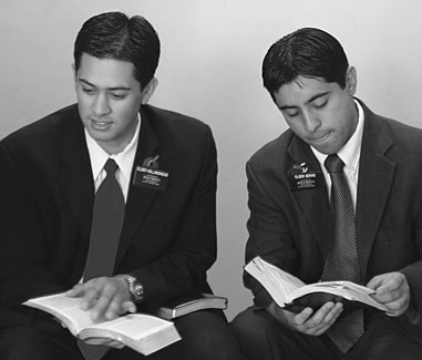 Missionaries studying on chairs