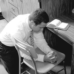 Missionary praying on chair