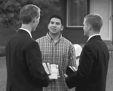 Missionaries talking with man